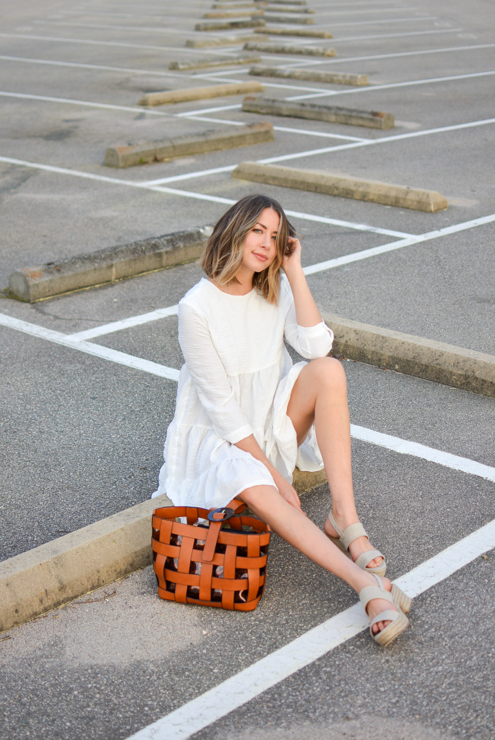 allie wears white puff sleeve dress